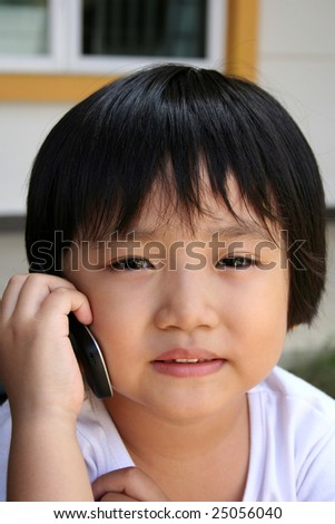 Cute little girl talking on the mobile phone - stock photo