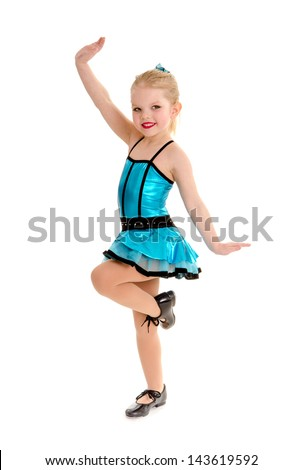 Cute Little Girl Tap Dancer Poses with Leg  Lifted in Tap Shoes and Costume