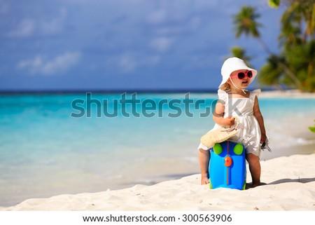 cute little girl travel on summer beach, kids travel - stock photo