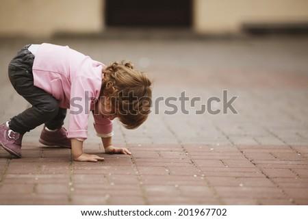cute little girl urban portrait - stock photo