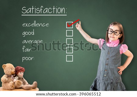 Cute little girl wearing business dress and checking excellence on customer satisfaction survey form. Showing on green chalk board. - stock photo