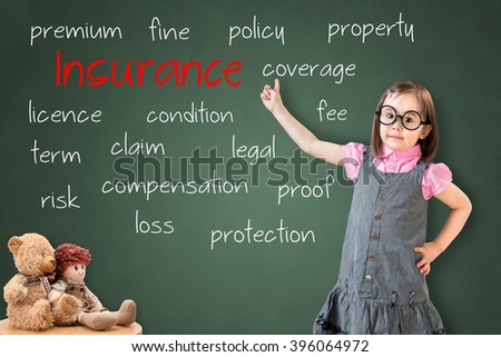 Cute little girl wearing business dress and showing insurance concept on green chalk board. - stock photo