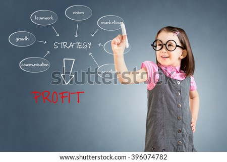 Cute little girl wearing business dress and writing a schema at the whiteboard with ideas for a good strategy to make profit. Blue background. - stock photo