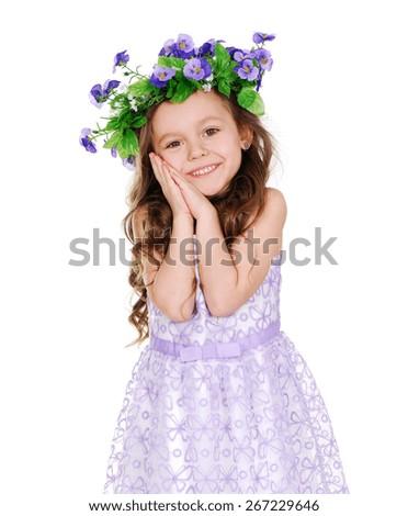 cute little girl wearing flower headband - stock photo