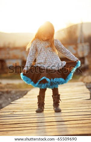 Cute little girl wearing tutu skirt - stock photo