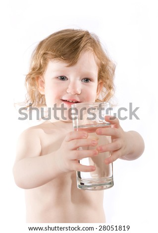 cute little girl with a glass of clear water - stock photo