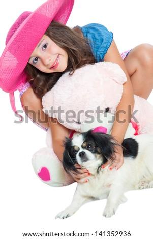cute little girl with a teddy bear and pekingese - stock photo