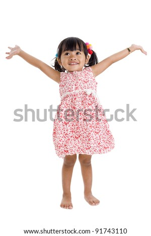 cute little girl with arms outstretched - stock photo