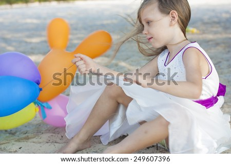 Cute little girl with balloons - stock photo