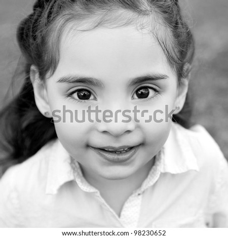 Cute little girl with big brown eyes - black and white - stock photo