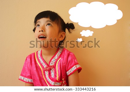 Cute little girl with blank speech bubble, selective focus - stock photo