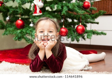 cute little girl with christmas tree - stock photo