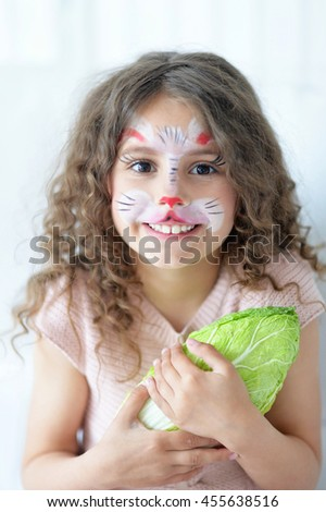Cute little girl with face painted - stock photo