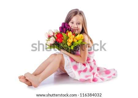 Cute little girl with flowers on white - stock photo