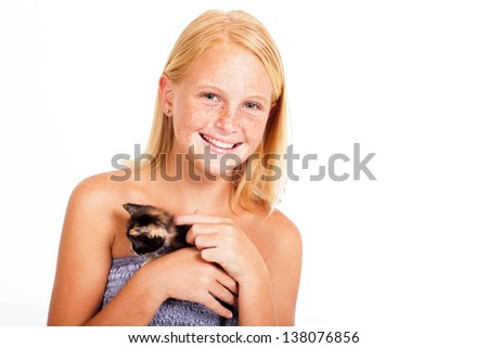 cute little girl with freckles holding a kitten - stock photo