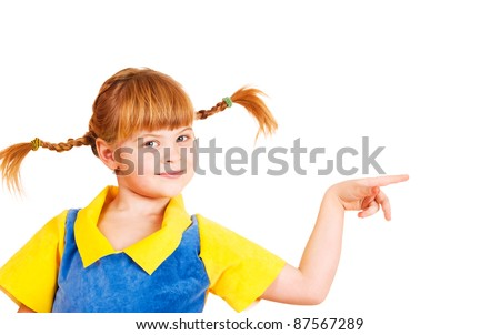 Cute little girl with funny braids pointing to the right - stock photo