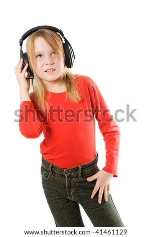 Cute little girl with headphones listening to music - stock photo