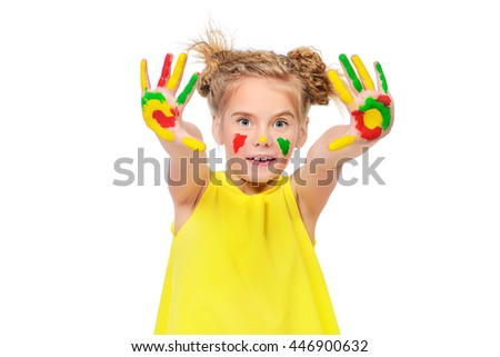 Cute little girl with painted colorful hands. Happy childhood. Isolated over white. - stock photo