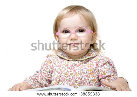 Cute little girl with silicone glasses reading book