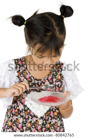 cute little girl with sweet dessert, isolated on white background - stock photo