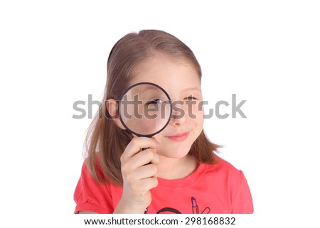 cute little girl with the magnifying glass - stock photo
