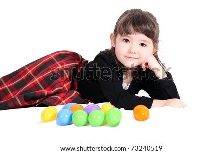 cute little girls lying with easter eggs isolated on a white background