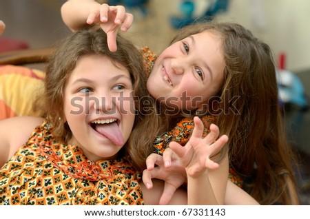 cute little girls making a face - stock photo