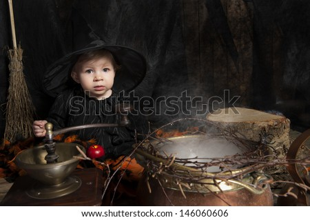 cute little halloween witch  - stock photo