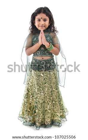 Cute little Indian girl in a greeting pose, isolated white background - stock photo