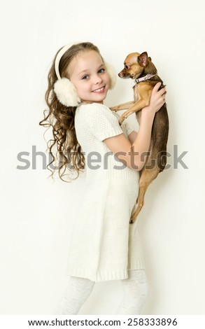 Cute little kid girl with small pet dog - stock photo