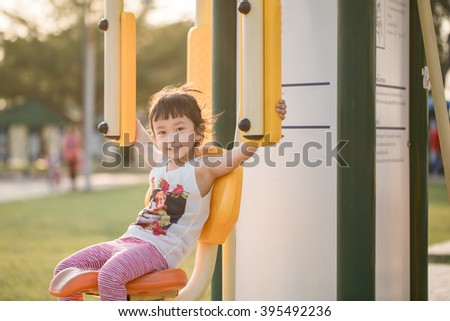 Cute little kid playing exercise.