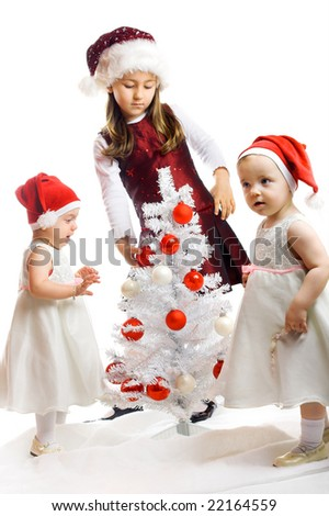 cute little kids with a christmas-tree