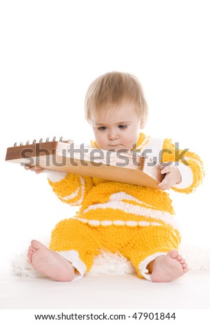 Cute little musicians play his instruments - stock photo