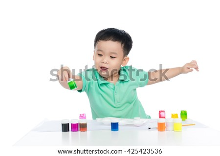Cute little preschooler asian boy child painting and looking at camera. shooting in the studio on white background. - stock photo