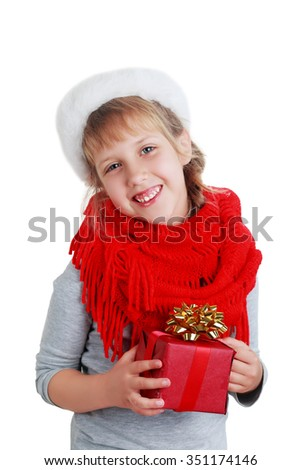 Cute little preschooler girl in red santa hat with gift box isolated on white - stock photo