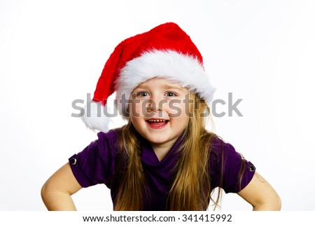 Cute little preschooler girl in red santa hat with gift box isolated on white, Christmas postcard