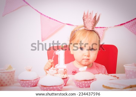 cute little princess at first birthday party - stock photo