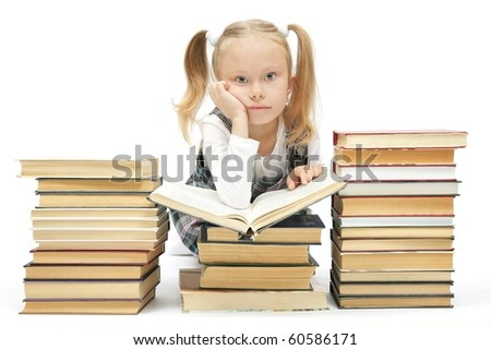 cute little schoolgirl reading a book studio shot on white