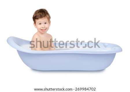 Cute little smiling boy washing in blue bath isolated on white background - stock photo