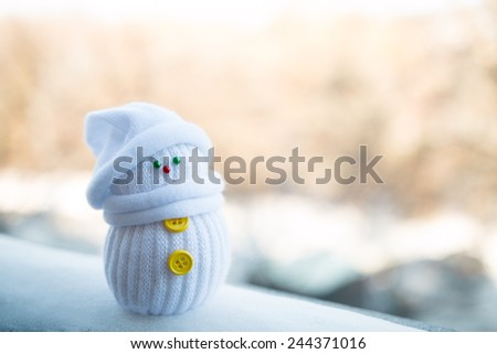 Cute little snowman on a blurry background - stock photo