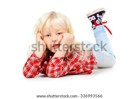 Cute little three year old girl lying on a floor and pensively looking at camera. Kid's concept, emotions. Isolated over white. - stock photo