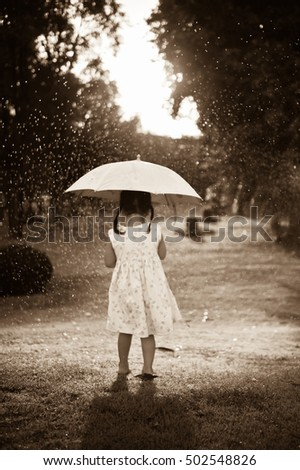 lonely girl walking alley park rainy stock photo 76606051
