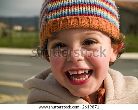 cute little vampire boy smiling at camera - stock photo