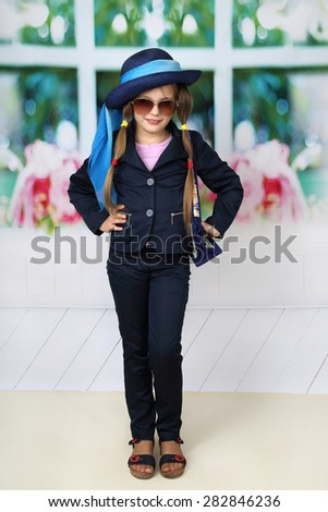 Cute long haired girl in blue hat - children beauty and fashion concept - stock photo