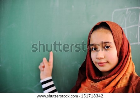 Cute lovely Arabic school children at clasroom having education activities - stock photo