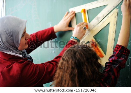 Cute lovely Arabic school children at classroom having education activities - stock photo