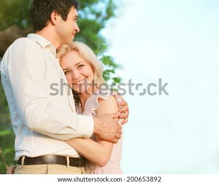 Cute lovely couple enjoying outdoors - stock photo
