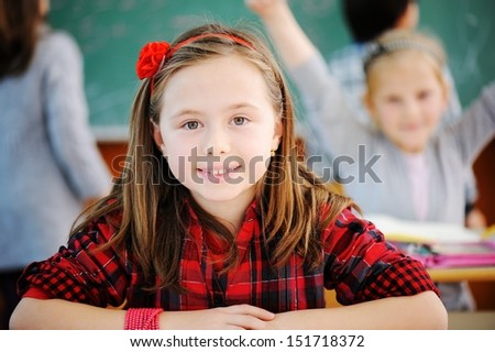 Cute lovely school children at clasroom having education activities - stock photo