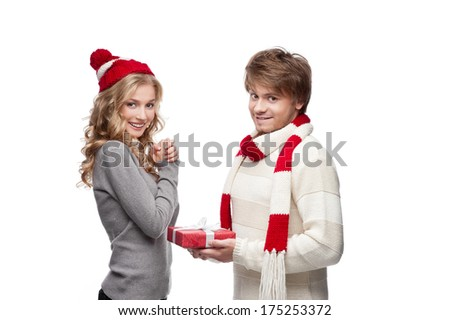 cute man presenting christmas gift to happy smiling woman - stock photo