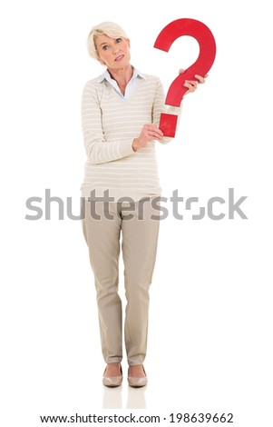 cute mature woman holding question mark on white background - stock photo